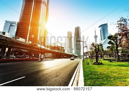skyline,road, and modern buildings at sunset in shanghai.