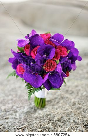 purple orchid and red roses bouquet