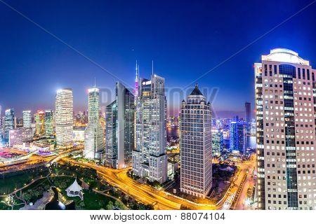 urban skyline and illuminated skyscrapers
