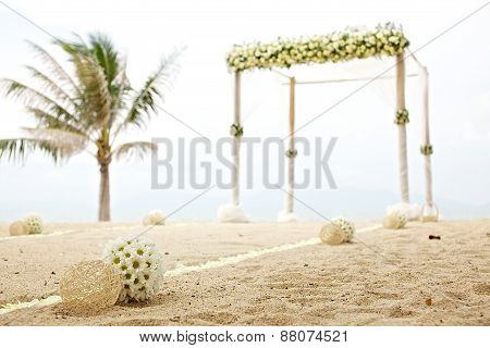 Wedding tent decorated with white flowers