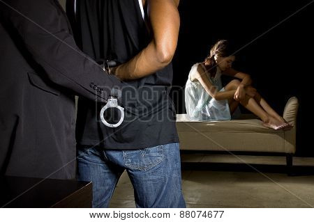 Man Being Arrested for Domestic Violence