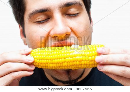 Young Man Eating Corn With Butter