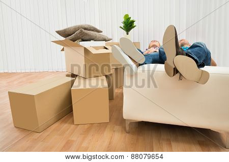 Couple Sleeping On Couch In New House