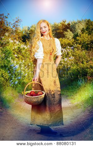 Beautiful girl with magnificent blonde hair wearing simple linen dress. Countryside. Summertime.
