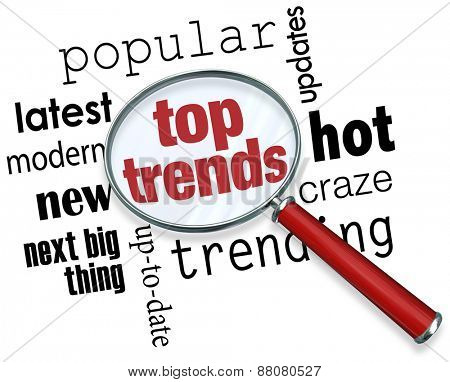 Top Trends words under a magnifying glass to illustrate the latest, hottest, most popular trends, news and updates to keep you informed