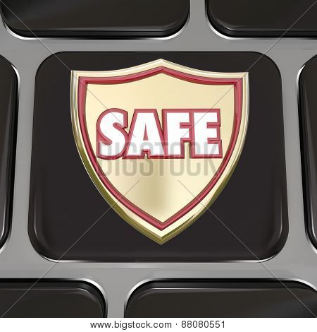 Safe word on a gold shield on computer keyboard key or black button to illustrate protection from virus, online theft or fraud or other danger or criminal activity