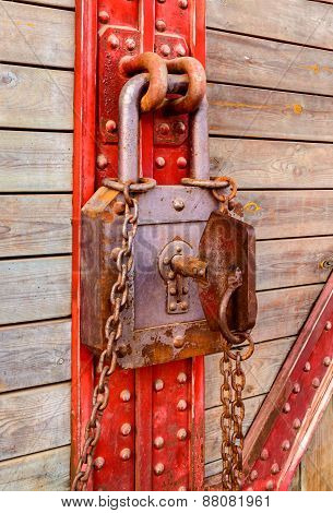 Old Wooden And Metal With Rusty Key