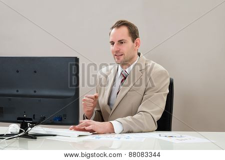 Businessman With Computer And Graphs