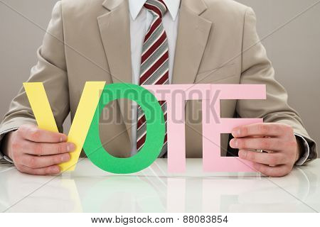 Businessperson With The Word Vote