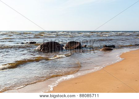 Shoreline Of Baltic Sea Beach With Rocks And Sand Dunes