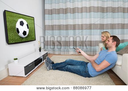 Couple Watching Football Match