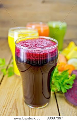 Juice beetroot and vegetable with parsley on board