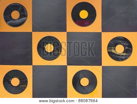 Orange And Black Color Paint With Center Gramophone Record On Square Wood