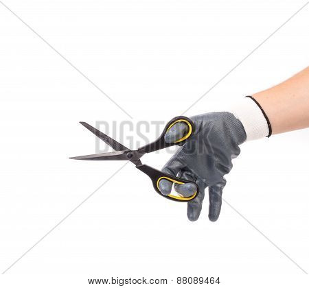 Male hand holding scissors.