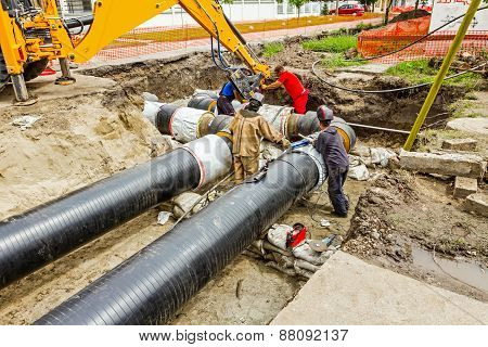 Team Of Workers On Building New Pipeline