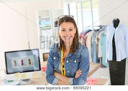 Portrait of smiling fashion designer in studio
