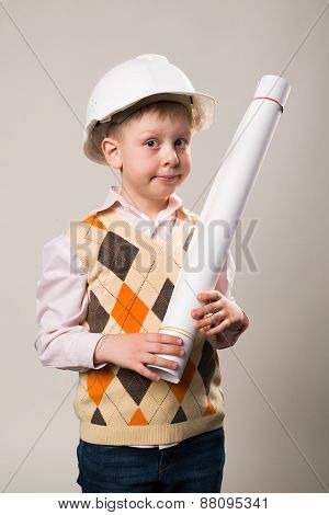 Boy In A Construction Helmet Holding A Drawing