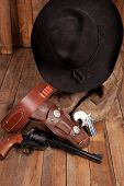 image of pistols  - A cowboy hat and pistol on a wooden background - JPG