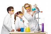 picture of chemistry  - Teens and teacher of chemistry at chemistry lesson making experiments isolated on white background - JPG