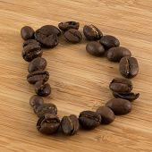 pic of letter d  - The letter d in coffee beans on wood - JPG