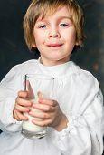 image of milkman  - milkman boy holding a glass of milk - JPG