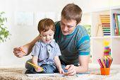 pic of nursery school child  - child boy painting in nursery at home - JPG