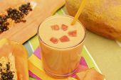 image of papaya fruit  - Fresh papaya smoothie on a table with papaya fruit - JPG