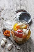 pic of pickled vegetables  - Home preserving mixed vegetables by pickling in glass canning jars - JPG