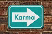 image of karma  - Karma Sign A teal sign with the words Karma on a brick wall - JPG