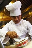 picture of chinese food  - chef do finishing touch on chinese food - JPG