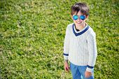 picture of rapture  - Cheerful little boy having relax outdoors during his summer vacation - JPG