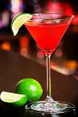 pic of cosmopolitan  - Cosmopolitan cocktail decorated with lime shot on a bar counter in a nightclub - JPG