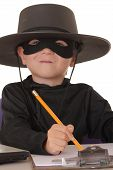 stock photo of zorro  - child as costumed zorro at laptop helpdesk - JPG