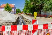 stock photo of safety barrier  - Construction site is protected by fence with flashing beacon lights for safety - JPG