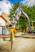stock photo of hydraulics  - Excavator has attached hydraulic plug - JPG