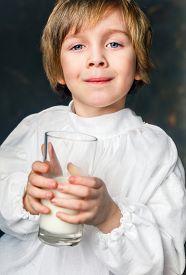 pic of milkman  - milkman boy holding a glass of milk - JPG
