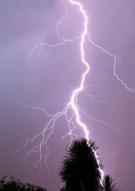 foto of lightning-rod  - Thunderbolt of lightning at night during a thunderstorm - JPG