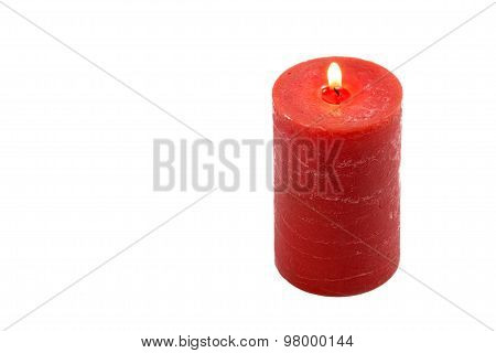 Red candle with flame