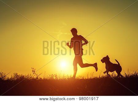 Man running with his four-legged friend