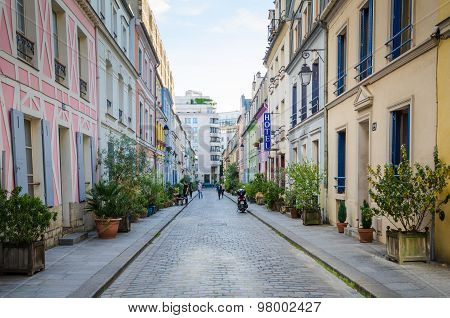 People are walking along Rue Cremieux in Paris
