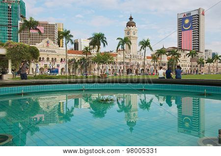 Buildings at the Independence square reflected in the fountain in Kuala Lumpur, Malaysia.