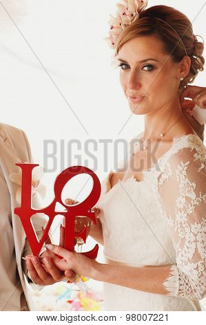 Beautiful  Gorgeous Blonde Bride With Letters Love, Hawai  Colorful Sand Ceremony On Cyprus