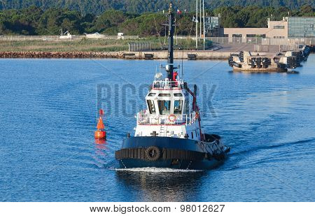 Tug Boat Goes On A Fairway In Porto-vecchio