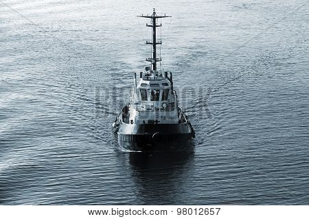 Tug Boat Underway, Front View, Dark Blue Tone