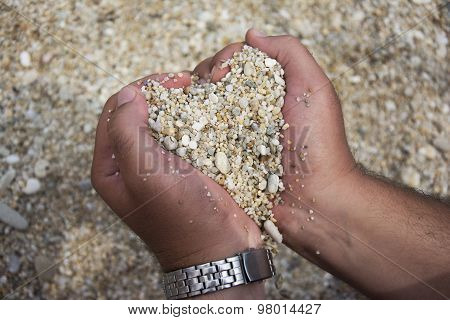 Heart Shape Made Of Pebbles In Male Hands