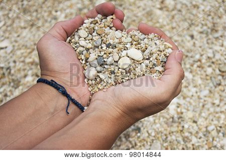 Heart Shape Made Of Pebbles In Female Hands