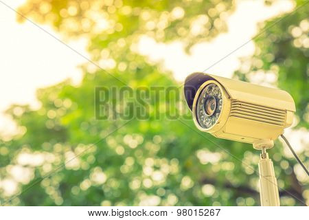 Close up of security surveillance camera ( Filtered image processed vintage effect. )
