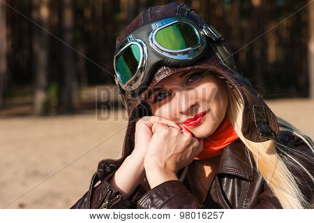 charming woman in helmet of the pilot