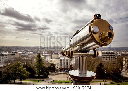 Tourist telescope positioned above the city of Paris. The view is from The Sacre Coeur in Montmartre