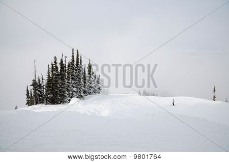 Solitary Skier Gliding Up The Slope